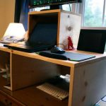 standing desk with box shape white flat keyboard notebook telephone set computer set