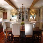 stunning french interior style with cozy leather chairs and large wooden cabinet feat luxurious chandelier with exotic kitchen islan in hardwooden flooring idea