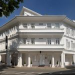 three floored hotel white painted window frame white main door white painted hotel old hotel building design beautiful white hotel The Club Hotel in Singapore