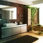 traditional bathroom idea with ravishing floating cabinet also elegant black granite walling with large rectangular mirror also black fur rug in green vegetation concept