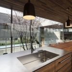 traditional japanese kitchen with wonderful wooden material also undermount sink with elegant gray chairs and large glass window overlooking the garden