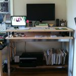 two platforms standing desk flat-screen computer unit netbook unit file shelving unit high-tech printer  audio system