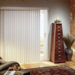 vertical window shades in white pyramid cabinetry clay-made vase ornament with dried-grass ornament classic standing lamp Turkish rug