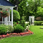 well groomed green grass beautiful house garden colorful flowers small front porch white painted veneer beautiful house exterior