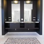 white and grey mosaic tiled flooring black and white wall square high mirror floating black vanity with metallic counter downlights undermount iron sink iron modern faucets