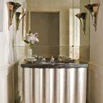 White Wall Floor To Ceiling Mirror Brass Sconces Glass Vase White Vanity With Black Granite Counter White Undermount Sink Glass Hanging Lamp White Wood Door Cream Tiled Flooring
