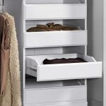 winning white drawers with elegant clothes and ravishing white wall in laminate flooring