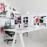 wonderful white office home with artisitc wall design and unique sloping ceiling with elegant white bookshelves