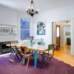 wonderuful dining room design with a touch of purple shade feat elegant white wall decoration and classic dining set furniture in laminate flooring idea