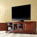 wood media console with center glass door storage plus cabinets  flat-screen TV set