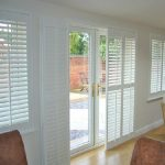 French door with glass panel and manual shutters feature  glossy wood finishing floor