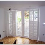 a new model of French door with open and closed shutters wood planks flooring design