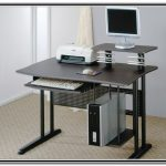 a printer on a standing compputer desk with additional sliding panel for keyboard  a computer set and CPU