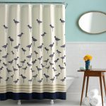 artistic bird patterns shower curtain with stainless steel shower curtain rod round ornamental mirror with unique carved frame  a blue vase with yellow flower ornament