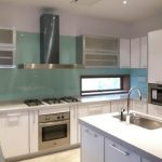 attractive nice adorable wonderful amazing awesome acrylic backsplash  with green color design with nice design for modern kitchen