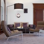 Black Leather Sofa With Pillows Two Sets Of Reading Chairs With Purple Pillows And White Metal Legs Elegant Carpet For Living Room A Unique Standing Lighting