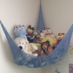 blue wool animal collection storage that is hang in the corner