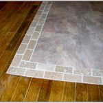 brush-wood finishing floor to light grey smaller tiles and larger tiles transition