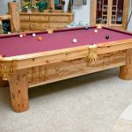 carved pool table made from wood material with red surface