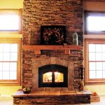cedar fireplace mantel with an abstract painting a gas fireplace building with  bricks-material construction