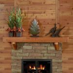 cedar mantel on fireplace top with beautiful plant decoration a gas fireplace with brick wall system idea wood planks for wall system