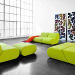cheerful green modular furniture in living room unique leaning wall decoration a casual stand lighting fixture a bottom to top glass window