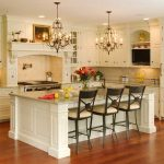 classic-style kitchen island and seating beautiful flower arrangement as the kitchen island ornament two sets of classic pendant light fixtures  small kitchen set in white color darker wood finish floor