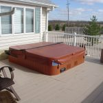 closed-outdoor hot tub on roof house white wood floor in plank shape furniture patio in rattan material white fences