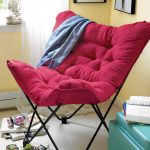 cozy reading chair in red with tiny black metal legs