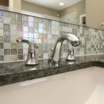 dark grey and white groutless tiles for backsplash area a square white vessel sink and stainless steel faucet
