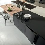 elegant black nanotech countertop with built-in electric stove fixture simple but high-class look of brushed-wood dining table with black plastic dining chairs