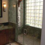 frameless glass door shower zone  with natural stone tiles ceramic tiles for bathroom floors