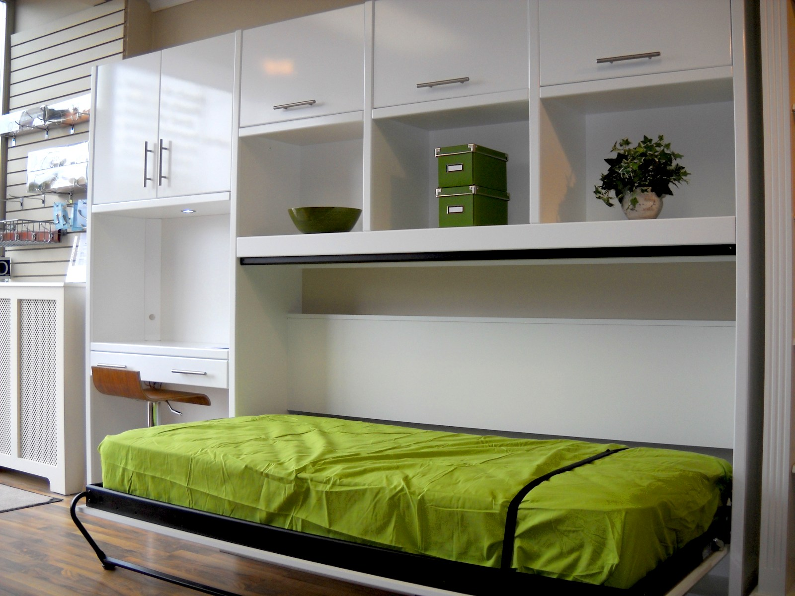Green Mattress Folded Bed Unit With Mini Desk And Single Cabinet On The Left