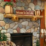 half cedar wood fireplace chimney-piece with decorations a gas fireplace with river rocks wall system