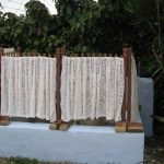 hide wood pool equipment with white drapes