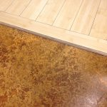 high-class look granite floor to unfinished-wood floor transition
