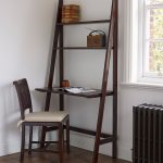 Ladder Desk With Chair A Radio Set And A Pile Of Books Hardwood Finish Flooring