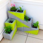 layered-concrete planter boxes with half-way green color and beautiful plants and flowers