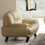 light brown leather sofa with blackwood legs light grey fury carpet  large white porcelain concrete planter box with a palm plant