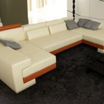 light-cream sectional sofa unit with brown strip decoration elegant black fury carpet  solid black wood table