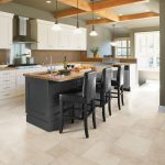Light Grey Vinyl Floor Classy Black Kitchen Island  With Hardwood Top Three Wood Dining Chairs In Black Color Luxurious Pendant Lights With Black Metal Hanger  Small Brown Tiles For Bakcsplash