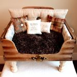 luxurious and comfortable dog crate looks like a mini daybed with brown fury mattress and some decorative pillows