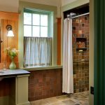 mesmerizing orange and green bathroom with brick wall concept also large mirror with ecelctic mosaic flooring for contemporary house design