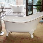 minimalist white tub fixture with standing water tap feature brown soft carpet with splash-patterns  wide sliding glass door