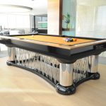 modern and unique private pool table with yellow surface for playing billiard and under metal cage model
