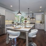 modern kitchen remodel  dining furniture in white-tone casual pendant lamps stainless steel-surface kitchen appliance white-wood finish kitchen cabinets clear-lines wood flooring