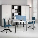 modern minimalist office desk for two workers with panel divider in the center movable office chairs in blue large cupboards with shelves for documents in the center