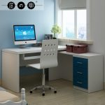 Modern Minimalist  Small Corner Computer Desk With Under Sliding Panel  Two Brown Boxes For Storage Fresh And Beautiful Ornamental Plant A Pile Of Books And A Book Arrangement White Chair With Wheels