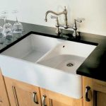 nice cool adorable wonderful cool best kitchen sink with white accent design and has black surface with brown wooden cabinet