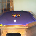 nice cute adorable awesome elegant cool unique pool table  with wooden frame concept design and has blue surface with eight holes concept